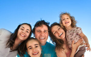 Young family smiling into the camera