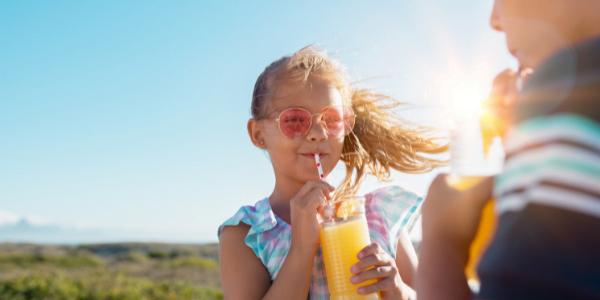 Children drinking orange juice
