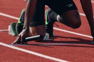 Relay sprinter getting ready to run