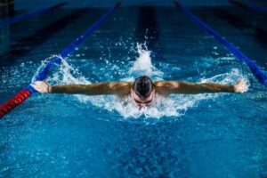 Male swimming in a pool