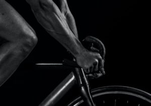 Cycling athlete pictured with hands on the handlebars