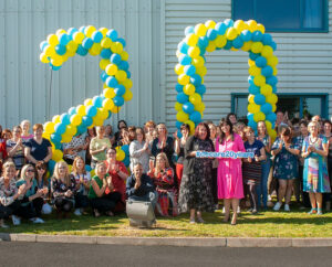 Picture of the DeCare team celebrating 20 years in business