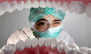 Dentist looking into someone's mouth