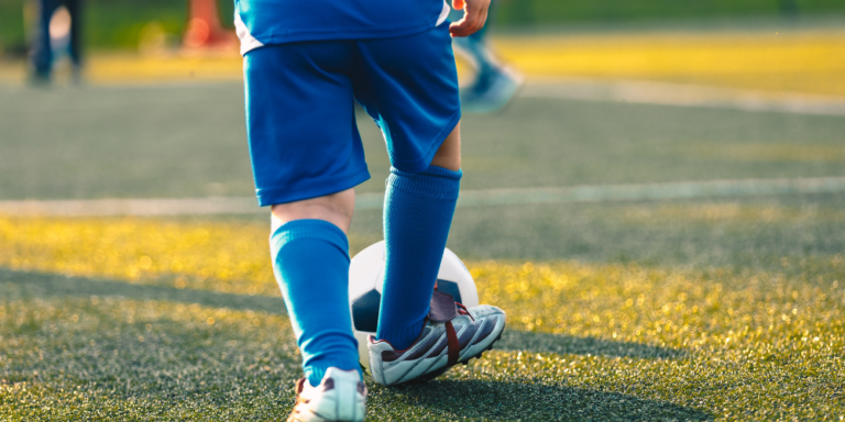 Young child playing soccer
