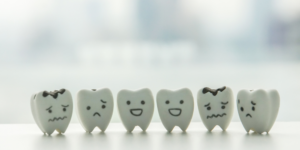 Row of fake teeth with funny faces